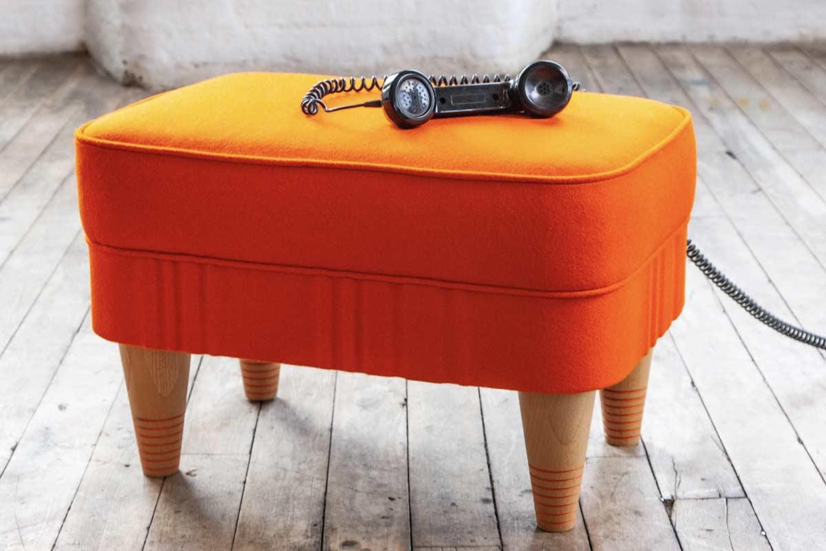 Footstool orange with phone